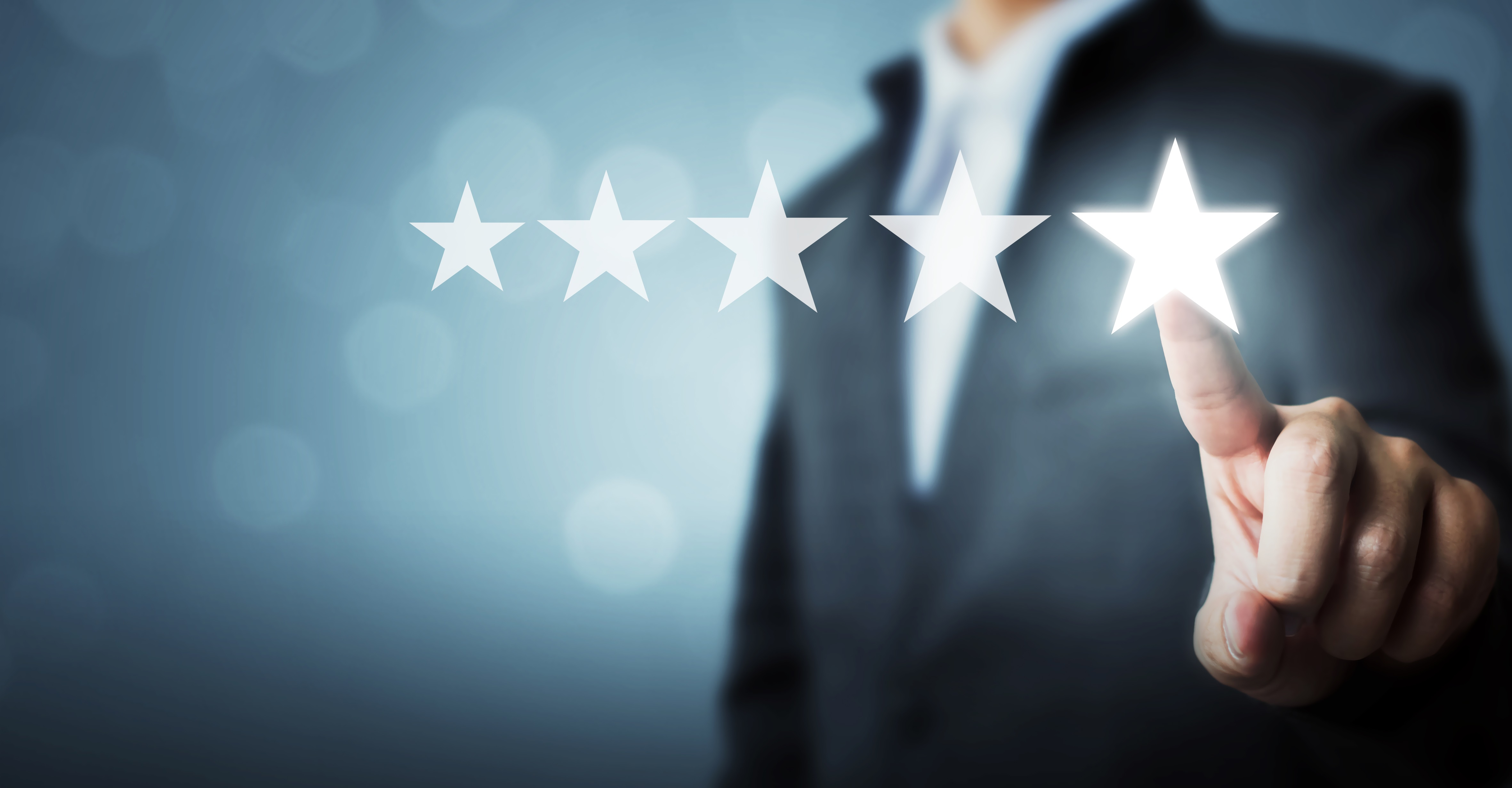 Man in suit reaches forward to touch the fifth star denoting five-star service with Customer Satisfaction written below