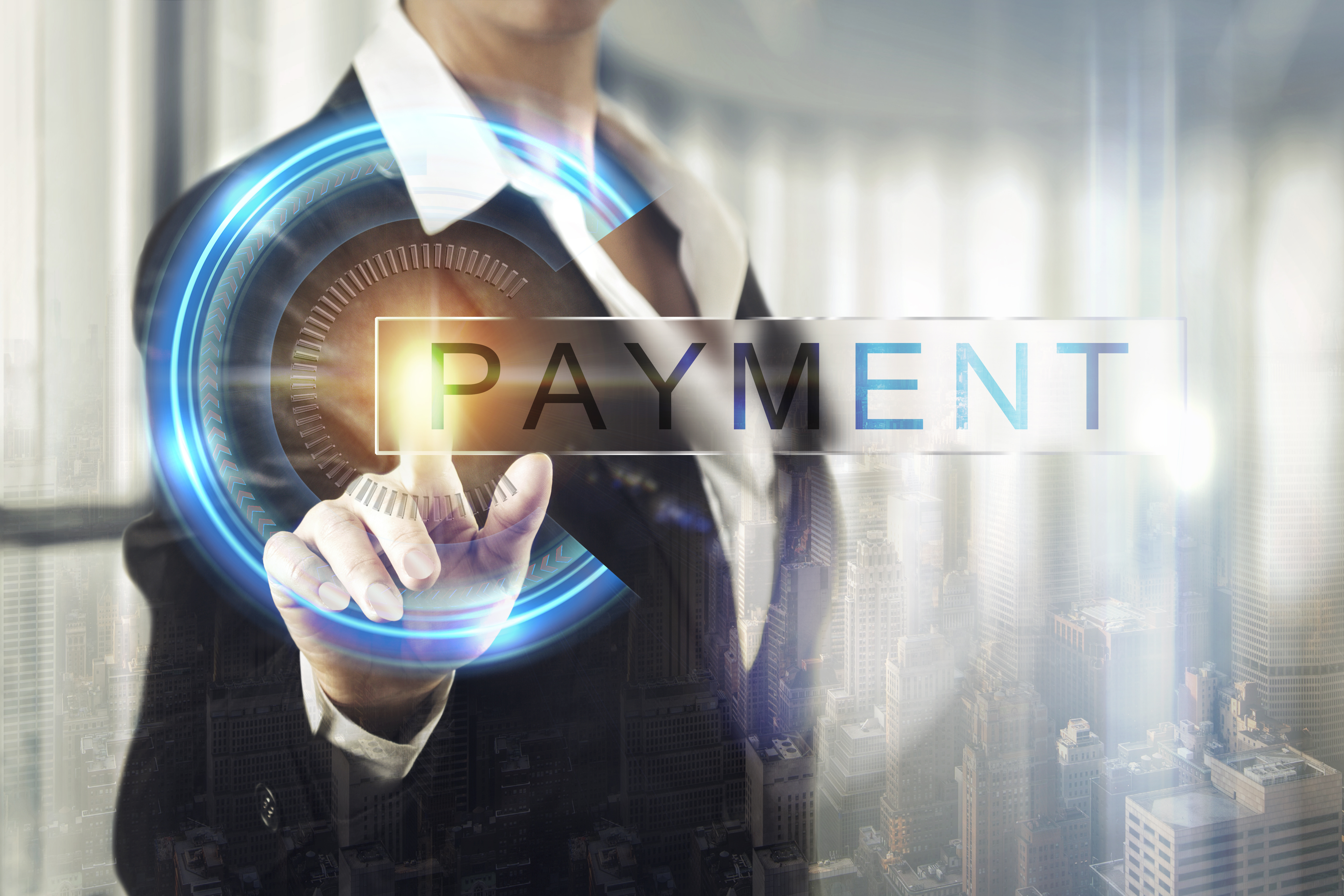 woman in suit presses finger to neon blue button that reads Payment in foreground